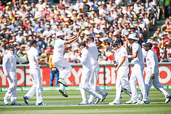 © Licensed to London News Pictures. 27/12/2013. The England team celebrate after getting a wicket during Day 2 of the Ashes Boxing Day Test Match between Australia Vs England at the MCG on 27 December, 2013 in Melbourne, Australia. Photo credit : Asanka Brendon Ratnayake/LNP