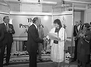 28/10/1985<br /> 10/28/1985<br /> 28 October 1985<br /> Launch of Gaisce The Presidents Award at Aras an Uachtarain. President Dr. Patrick Hillery launched the new national youth award scheme to be the nations highest award to Irish young people aged 15-25. Picture shows Niamh Ni Bhaoil, (left) presenting her pledge to President Hillery.  Dr. Tony O'Reilly is on the left.