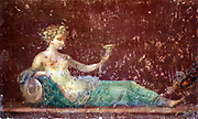 Painting at Pompeii. Wall-paintings in ancient Rome decorated the interiors of private houses and public buildings such as baths and temples, as well as more humble shops, taverns and even brothels.