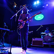 "WASHINGTON, DC - February 14th  2013 - Dominic Simper, Kevin Parker and Julien Barbagallo of Tame Impala perform at the 9:30 Club in Washington, D.C.  The band's sophomore album, ""Lonerism,"" was released in October of 2012 and won numerous album of the year awards across the globe, including NME, Rolling Stone and Australia's Triple J radio. (Photo by Kyle Gustafson/For The Washington Post)"