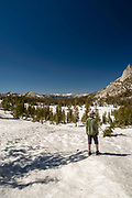 Afternoon view of Cathedral Peak in Yosemite National Park, on the John Muir Trail. Cathedral Lake is below, frozen over.