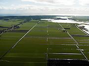 Nederland, Friesland, Gemeente Sudwest-Fryslan (Zuidwest-Friesland), 16-04-2012. 'It Lege Midden' (het lage midden). Groote Noordwolderpolder. Veenveenpolder, is drooggemaakt na het vervenen. Achter de polder het meer De Holken, IJsselmeer aan de horizon. ..Typical Frisian countryside: lakes, sparse farms in the polders, meadows..luchtfoto (toeslag), aerial photo (additional fee required);.copyright foto/photo Siebe Swart