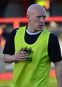 Matt Richards warms up during the Sky Bet League 2 match between Cheltenham Town and Cambridge United at Whaddon Road, Cheltenham, England on 14 April 2015. Photo by Alan Franklin.