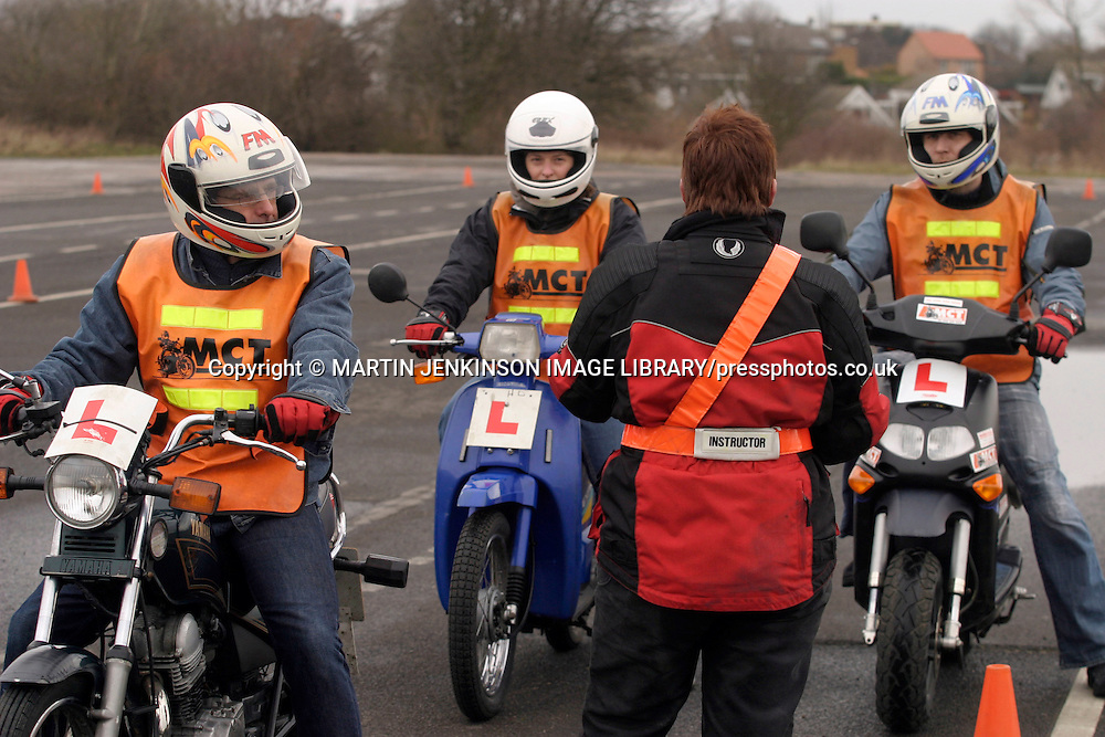 Instructor with learner riders doing Compulsory Basic Training before they can ride on the public highway....