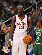 Jan. 28, 2011; Phoenix, AZ, USA; Phoenix Suns guard Mickael Pietrus (12) reacts on the court against the Boston Celtics at the US Airways Center.  The Suns defeated the Celtics 88-71. Mandatory Credit: Jennifer Stewart-US PRESSWIRE