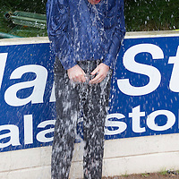 St Johnstone's Paul Smith is subjected to the Ice Bucket Challenge by Tom Scobbie and Fraser Wright...29.08.14<br /> Picture by Graeme Hart.<br /> Copyright Perthshire Picture Agency<br /> Tel: 01738 623350  Mobile: 07990 594431
