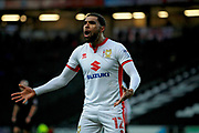 MK Dons Scott Golbourne (12) not happy with the decision from the linesman during the EFL Sky Bet League 1 match between Milton Keynes Dons and Peterborough United at stadium:mk, Milton Keynes, England on 30 December 2017. Photo by Nigel Cole.