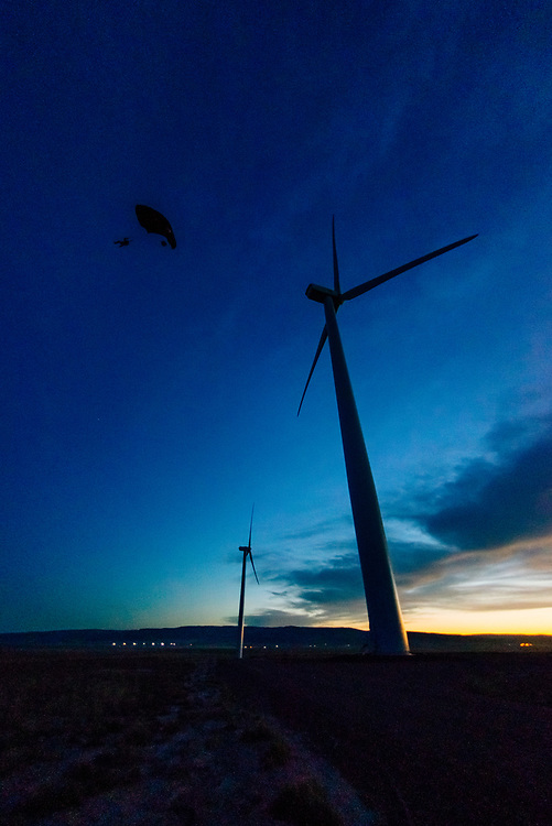 Base Jumping off a wind turbine at dusk
