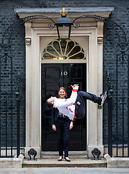 © Licensed to London News Pictures. 04/06/2018. London, UK. Gold medal winning gymnast Dominick Cunningham performs a backflip in front of Sports Minister Tracey Crouch MP outside 10 Downing Street. Photo credit: Rob Pinney/LNP