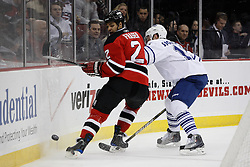 Feb 5, 2010; Newark, NJ, USA; New Jersey Devils defenseman Mark Fraser (2) plays the puck away from Toronto Maple Leafs right wing Fredrik Sjostrom (11) during the first period at the Prudential Center.