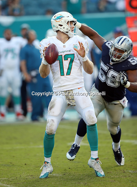 Miami Dolphins quarterback Ryan Tannehill (17) gets sacked from behind by Dallas Cowboys defensive end Jack Crawford (58) as he tries to throw a pass during the 2015 week 11 regular season NFL football game against the Dallas Cowboys on Sunday, Nov. 22, 2015 in Miami Gardens, Fla. The Cowboys won the game 24-14. (©Paul Anthony Spinelli)