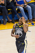 Golden State Warriors forward Andre Iguodala (9) reacts to being hit in the head on a lay up against the New Orleans Pelicans at Oracle Arena during Game 2 of the Western Semifinals in Oakland, California, on May 1, 2018. (Stan Olszewski/Special to S.F. Examiner)