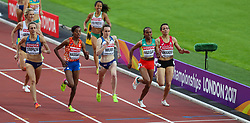 London, 2017-August-04. A sprint for the line ends in a photo finish in Heat 2 of the Women's 1,500m at the IAAF World Championships London 2017. Paul Davey.