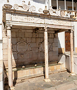 Water fountain built in the 16th century at Alter do Chão, Alentejo, Portugal, southern Europe. Built of marble there are Corinthian columns decorative motifs and friezes and Coats of Arms for the village and Dukes of Braganca