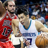 03 November 2015: Charlotte Hornets guard Jeremy Lin (7) drives past Chicago Bulls center Joakim Noah (13) during the Charlotte Hornets  130-105 victory over the Chicago Bulls, at the Time Warner Cable Arena, in Charlotte, North Carolina, USA.