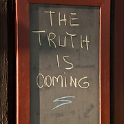 "THE TRUTH IS COMING"" Humorous Signs on the walls of The Dock Restaurant Bar in Montauk Long Island. Reflect the sense of humor and attitude of the bar's owner, George."