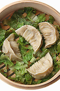 Streamed Gyoza (Jiaozi) in bamboo steaming basket