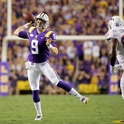 Sep 14, 2019; Baton Rouge, LA, USA; LSU Tigers quarterback Joe Burrow (9) throws under pressure by Northwestern State Demons defensive end Ty Cormier (93) during the second quarter at Tiger Stadium. Mandatory Credit: Derick E. Hingle-USA TODAY Sports