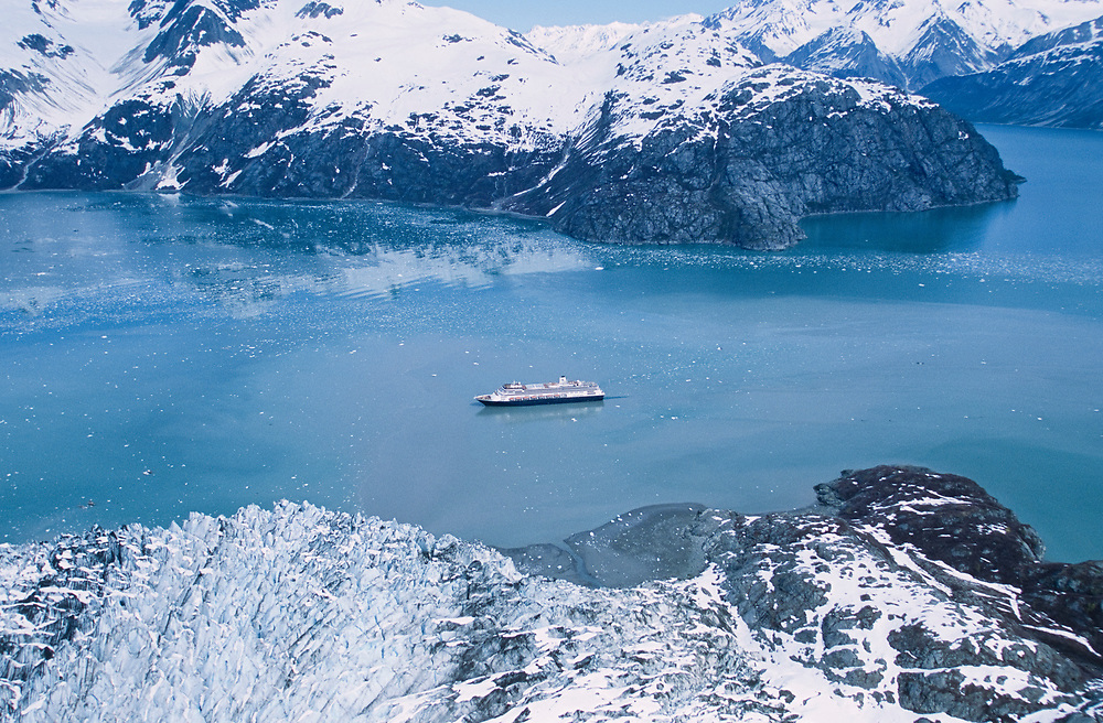 Alaska. Glacier Bay National Park. Holland America cruise ships in John Hopkins Inlet is dwarfed by the glaciers and mountains of the Fairweather Range.