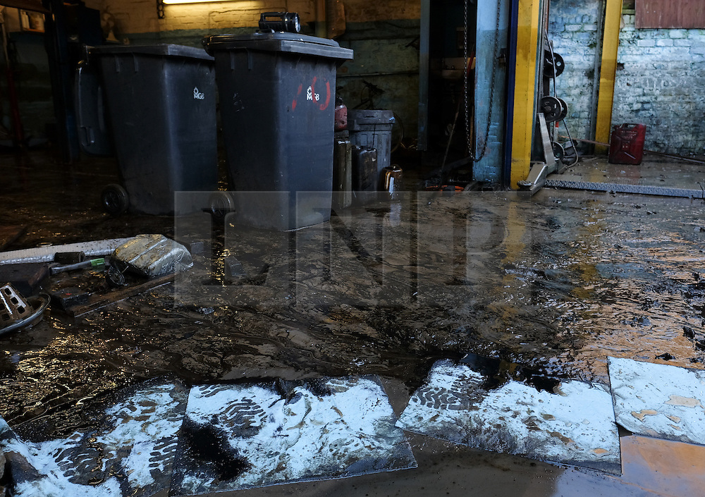 &copy; Licensed to London News Pictures. 29/12/15<br /> York, UK. <br /> <br /> Spill pads are used to absorb oil at a flooded motor engineering business as flood water begins to subside on Huntington Road in York. Further rainfall is expected over coming days as Storm Frank approaches the east coast of the country.<br /> <br /> Photo credit : Ian Forsyth/LNP