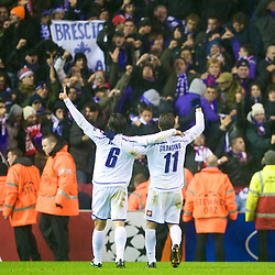 LIVERPOOL, ENGLAND - Wednesday, December 9, 2009: AFC Fiorentina's Juan Vargas and goalscorer Alberto Gilardino celebrate their late winning goal against Liverpool during the UEFA Champions League Group E match at Anfield. (Photo by David Rawcliffe/Propaganda)