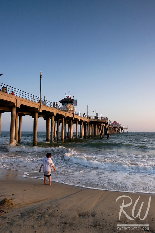 Young Boy Amazed by the Waves Next to Huntington Beach Pier, California