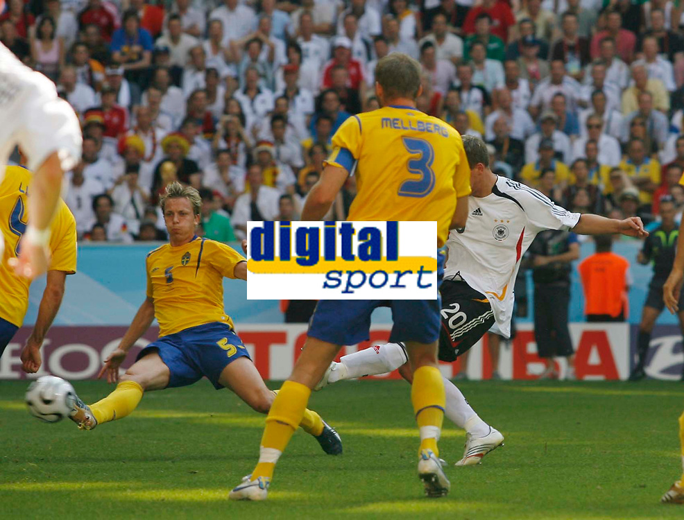 Photo: Glyn Thomas.<br />Germany v Sweden. Second Round, FIFA World Cup 2006. 24/06/2006.<br /> Lukas Podolski (R) scores Germany's second goal.