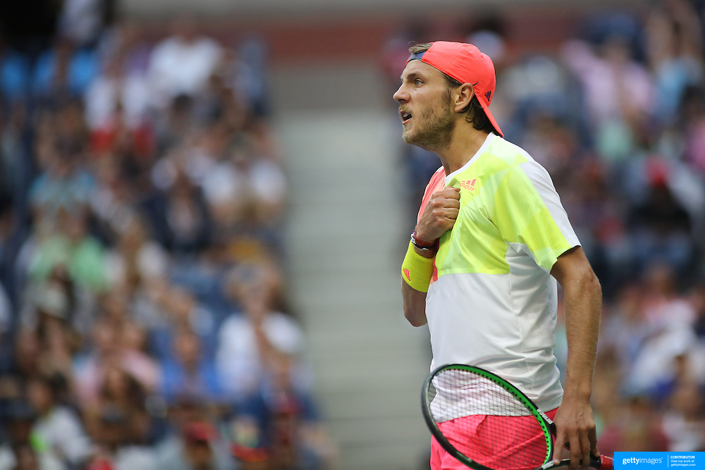 2016 U.S. Open - Day 7  Lucas Pouille of France reacts after winning a point against Rafael Nadal of Spain in the Men's Singles round four match on Arthur Ashe Stadium on day six of the 2016 US Open Tennis Tournament at the USTA Billie Jean King National Tennis Center on September 4, 2016 in Flushing, Queens, New York City.  (Photo by Tim Clayton/Corbis via Getty Images)