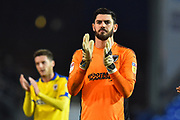 Tom King (1) of AFC Wimbledon applauds the travelling fans at full time after a 2-1 loss to Portsmouth during the EFL Sky Bet League 1 match between Portsmouth and AFC Wimbledon at Fratton Park, Portsmouth, England on 1 January 2019.