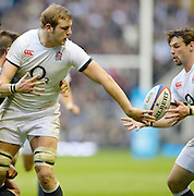 Twickenham, United Kingdom, England  Joe LAUNCHBURY,  passes the ball to Ben FODEN when tackled by Richie McCRAW, during the 2013 QBE  Autumn Rugby International, England vs New Zealand, played  Saturday  16/11/2013 at the RFU Stadium Twickenham, England. [Mandatory Credit: Peter Spurrier/Intersport<br /> Images}