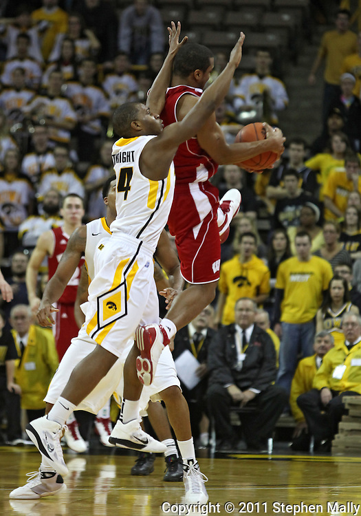 February 09 2011: Iowa Hawkeyes guard Bryce Cartwright (24) tries to breakup an inbound pass to Wisconsin Badgers guard Jordan Taylor (11) during the second half of an NCAA college basketball game at Carver-Hawkeye Arena in Iowa City, Iowa on February 9, 2011. Wisconsin defeated Iowa 62-59.