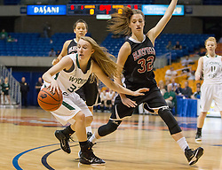 Wyoming East guard Allison England (23) is trapped by Bluefield center Dani Janutolo (32) during a first round game at the Charleston Civic Center.