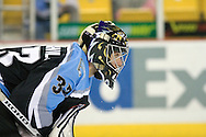 17 February, 2006 - Anchorage, AK:  Sweat drips from the face guard of Ace's goalie, Matt Underhill, who stopped 21 of 22 shots from the IceDogs in the Alaska Aces 5-1 victory over the visiting Long Beach IceDogs at Sullivan Arena.