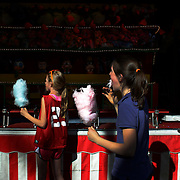 Young girls enjoy cotton candy while playing games during the May Fair at Saint Mark's Church, New Canaan, Connecticut, USA. 12th May 2012. Photo Tim Clayton