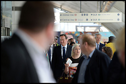 The Prime Minster David Cameron arrives at Stratford Station on his way to the Queen Elizabeth Olympic Park.<br /> Mayor of London Boris Johnson and Lord Coe will be taking to the stage at Go Local to encourage a new drive in volunteering one year on from the Games. Also present are multi-platinum selling pop rock band McFly; world famous comedian Eddie Izzard, Brit Award nominated The Feeling, and Britain'Got Talent winners Attraction, in addition to stars Jack Carroll and Gabz. The event will be the UKs biggest ever celebration of volunteering and first Olympic and Paralympic legacy event at Queen Elizabeth Olympic Park.<br /> London, United Kingdom<br /> Friday, 19th July 2013<br /> Picture by Andrew Parsons / i-Images