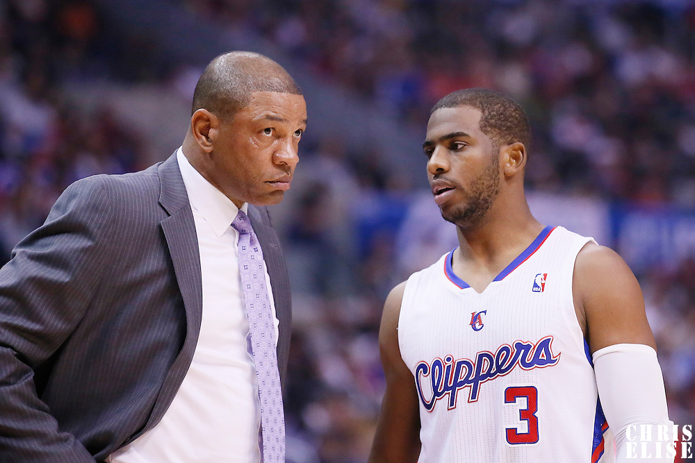 16 November 2013: Los Angeles Clippers point guard Chris Paul (3) talks to Los Angeles Clippers head coach Doc Rivers during the Los Angeles Clippers 110-103 victory over the Brooklyn Nets at the Staples Center, Los Angeles, California, USA.