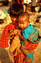 BURMA SHAN STATE TAUNGGYI MAR95 - Two Burmese children pose for a photo at the Taunggyi tribal market. .. jre/Photo by Jiri Rezac. . © Jiri Rezac 1995. . Contact: +44 (0) 7050 110 417. Mobile: +44 (0) 7801 337 683. Office: +44 (0) 20 8968 9635. . Email: jiri@jirirezac.com. Web: www.jirirezac.com