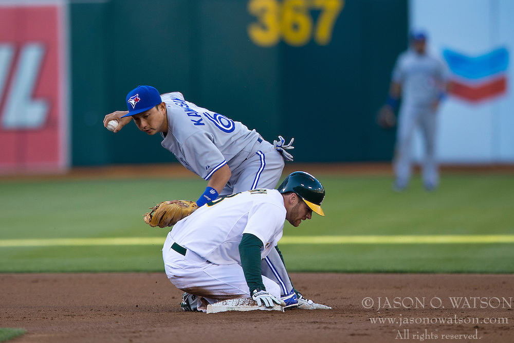 OAKLAND, CA - JULY 05:  Craig Gentry #3 of the Oakland Athletics slides into second base to break up a double play attempt by Munenori Kawasaki #66 of the Toronto Blue Jays during the first inning at O.co Coliseum on July 5, 2014 in Oakland, California. The Oakland Athletics defeated the Toronto Blue Jays 5-1.  (Photo by Jason O. Watson/Getty Images) *** Local Caption *** Craig Gentry; Munenori Kawasaki