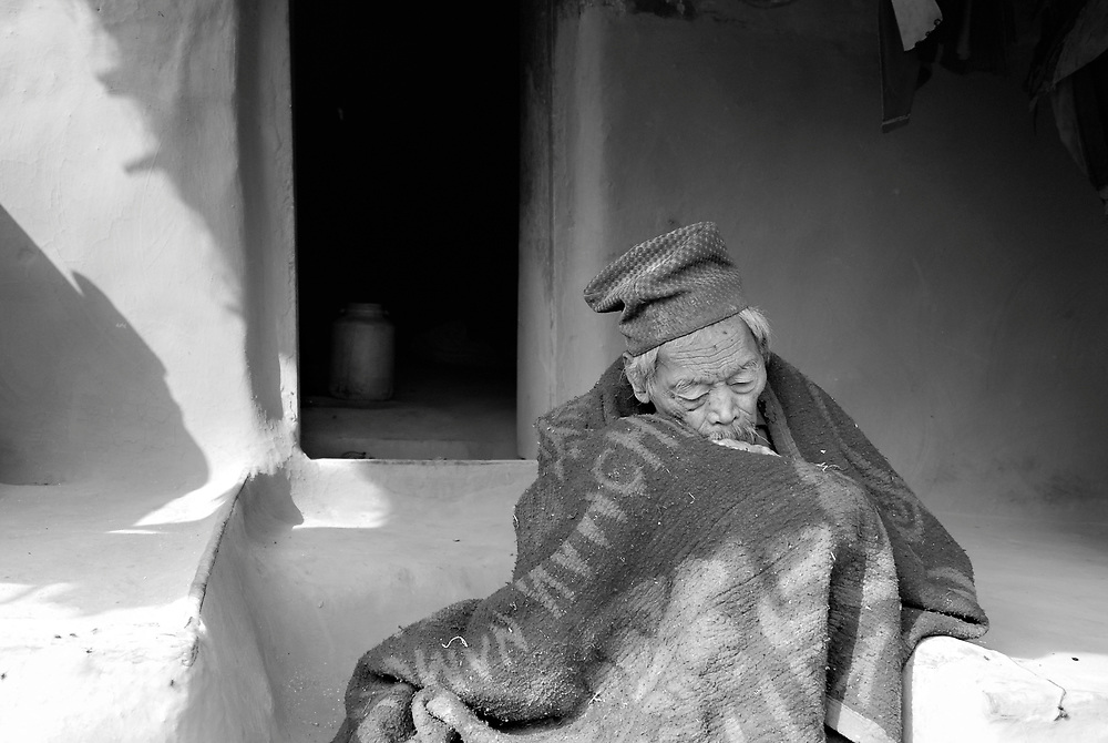 Nepal. 2008<br /> <br /> A 100 year old chepang man in a Nepali village, resting outside of his home.