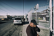 Armando Hernandez waits outside of the gates to see his wife and daughter, who are staying at the Instituta Madre Assunta Women's migrant shelter in Tijuana, Mexico on Monday, May 1, 2017.  Many people who come to the border are allowed to apply for asylum and are being shooed away by Customs and border protection agents(Photo by Sandy Huffaker/Zuma Press)