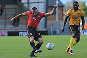 Max Muller of Morecambe shhots during the EFL Sky Bet League 2 match between Morecambe and Newport County at the Globe Arena, Morecambe, England on 16 September 2017. Photo by Mick Haynes.