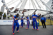 The Harlem Globetrotters demonstrate their basketball handling skills under the SkyView Atlanta ferris wheel during a downtown tour Monday, March 9, 2015, in Atlanta. David Tulis / AJC Special