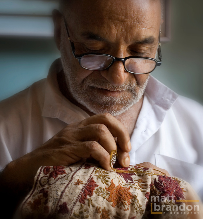 It takes many years of expertise to embroider as fine a work as this master craftsman can do.