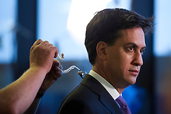 © London News Pictures. 25/09/2013 . Brighton, UK. Labour Party Leader ED MILIBAND having a microphone attached before giving an interview to television at The Brighton Centre the morning after delivering his Keynote speech at the Labour Party Conference. Photo credit : Ben Cawthra/LNP