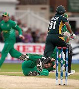 Wayne Parnell takes cover as Shoaib Malik runs off his bowling during the ICC World Twenty20 Cup semi-final between South Africa and Pakistan at Trent Bridge. Photo © Graham Morris (Tel: +44(0)20 8969 4192 Email: sales@cricketpix.com)