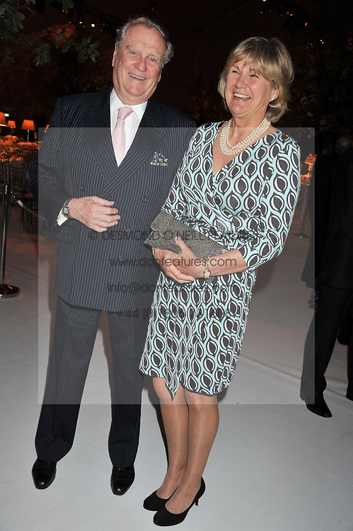 The EARL & COUNTESS OF SUFFOLK & BERKSHIRE at a dinner hosted by Cartier following the following the opening of the Chelsea Flower Show 2012 held at Battersea Power Station, London on 21st May 2012.