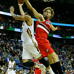 Dec 30, 2013; New Orleans, LA, USA; New Orleans Pelicans power forward Anthony Davis (23) shoots over Portland Trail Blazers center Robin Lopez (42) during the first quarter of a game at the New Orleans Arena. Mandatory Credit: Derick E. Hingle-USA TODAY Sports