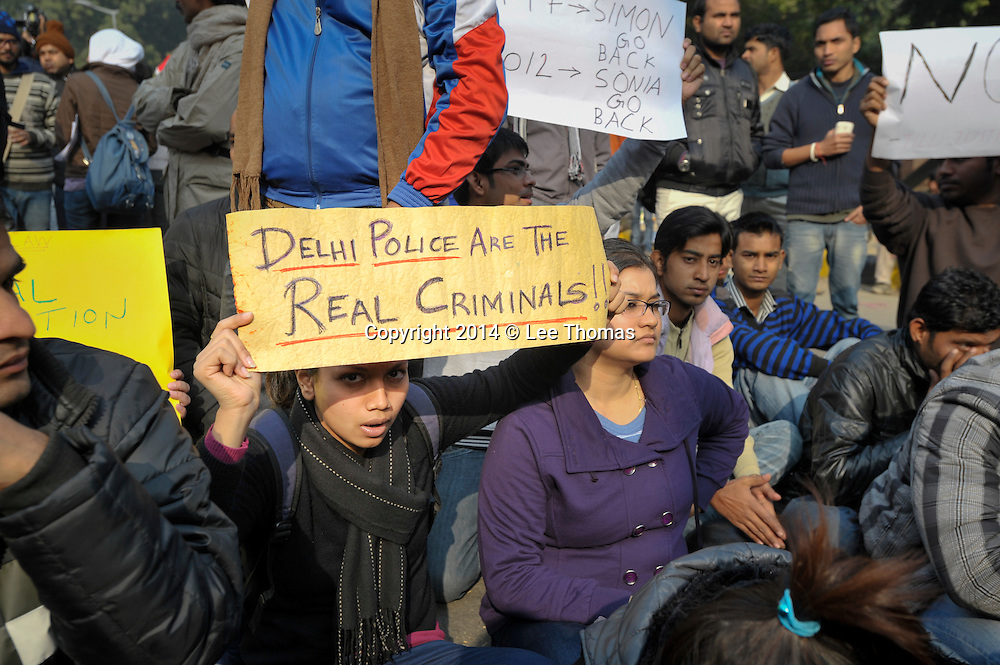 25th Dec. 2012. A young protester holds a banner in Jantar Mantar, New Delhi, suggesting Delhi Police are corrupt. Thousands of people gathered in the area to demonstrate in the aftermath of the gang-rape of a young medical student in the Indian capital.