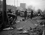 Car Bomb Damage in Dublin (E10)..1972.02.12.1972..12.02.1972..2nd December 1972..On the morning of 2nd December '72 two car bombs exploded in Dublin City. At Sackville Place two busmen were killed as they waited in their car to resume work. The busmen were named as George Bradshaw (30) and Thomas Duffy (23). The bomb was thought to be planted by a Northern Ireland subversive group who hoped to influence legislation going through Dail Eireann in relation to the I.R.A...Image of Gardai and investigators as they look for clues that they hope will lead to the apprehension of the bombers.