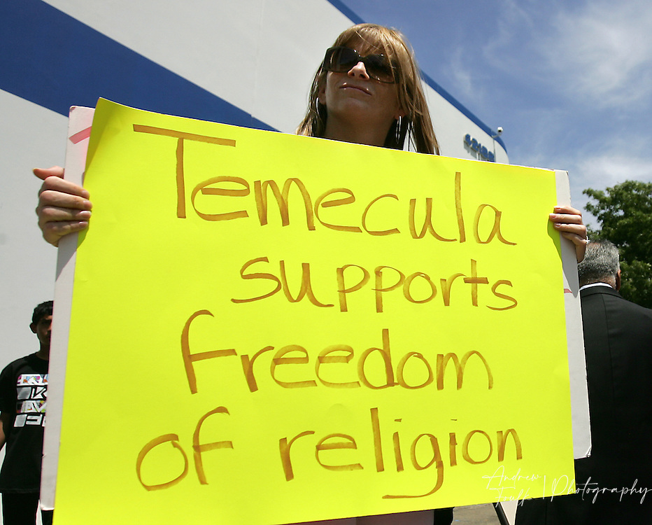 /Andrew Foulk/ For The Californian/ .Jennifer Eis, of Temecula, holds a sign supporting the Temecula  Islamic Center, during a protest staged by a group opposed to the building of a new mosque in Temecula